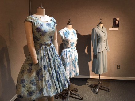 This trio of dresses caught the eyes of many at the galley. On left is a full skirted dress from the 1950s, a style that gained popularity after war years. In the center, from the collection of Isabelle Shippee Shaffer, is a synthetic garment that became popular in the late 1950s due to its low maintenance and convience. At the end is a two-piece suit from the 1940s.