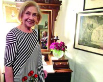 Gail Hines included red roses and fern leaves in her arrangement.