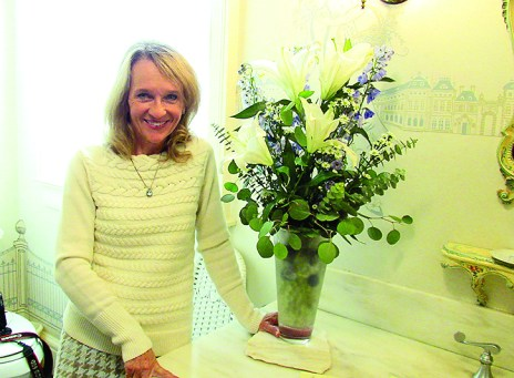 Juanita Murphy's arrangement consists of lilies, seeded eucalyptus, coffee beans, blue delphinium and mini daisies.