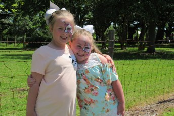 Ava Peppers and Delaney Poche had matching unicorns painted on their faces.