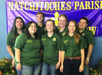 Lakeview FFA Chapter Officers volunteered at the Natchitoches Parish Fair by guiding elementary students throughout the fair exhibits. Members also volunteered to work the outdoor skills exhibits and assisted elementary students in coloring leaf prints, fishing and throwing logs. One member received the honor of being awarded the merit award from the Natchitoches Parish Fair Board. Zack Favela served the fair by working during the kid's day tours with Lakeview ROTC, checking on the needs of group leaders and offering his help in any capacity available. Lakeview FFA officers are, from left, Karmen Jarriet, Gracie Niette, Blake Smith, Meagan Corley, Joella Seay, Emily Windham and Salem Johnson.