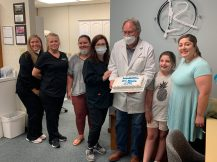 Dr. Lee Romine, local orthodontist, applied braces to his 10,000th patient Monday, Aug. 10. From left are Mallory Yount, Jessica Duirden, Caroline Bishop, Rindy Romine, Dr. Romine, 10,000th patient Addi Moore and her mother Kasie Moore.