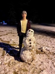 Brock Sylvia of Many and his first snowman, son of Chris and Frances Sylvia.