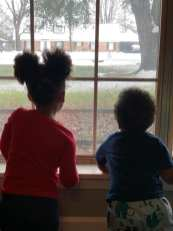 Lexie and Lawrence Seawood III enjoying the snow day view from indoors