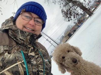 Lisa Greer, owner of Dirty Dawgs Groom Shop in Natchitoches, and her dog Hank, enjoying the snow.
