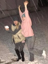 Kelly Yelverton and Madison Martin, right in the action of the snow coming down.