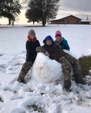 Rylee Pearson, Lake Rascoe and Weslyn Powell, enjoying the snow.