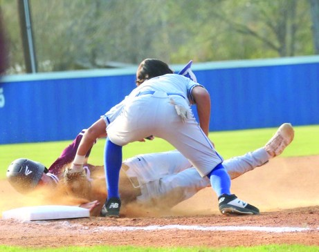 Sliding into the plate is #5 Alex Dupuy. Photo by Bailey Newlee