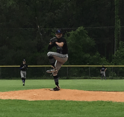 Payne Williams, pitching right handed in relief of himself!