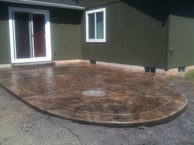COLORED, STAMPED, RADIUSED PATIO W FIRE PIT