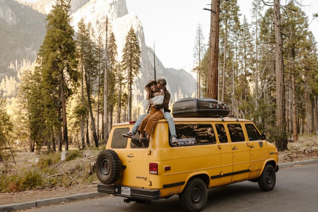 Couple sits together on yellow van
