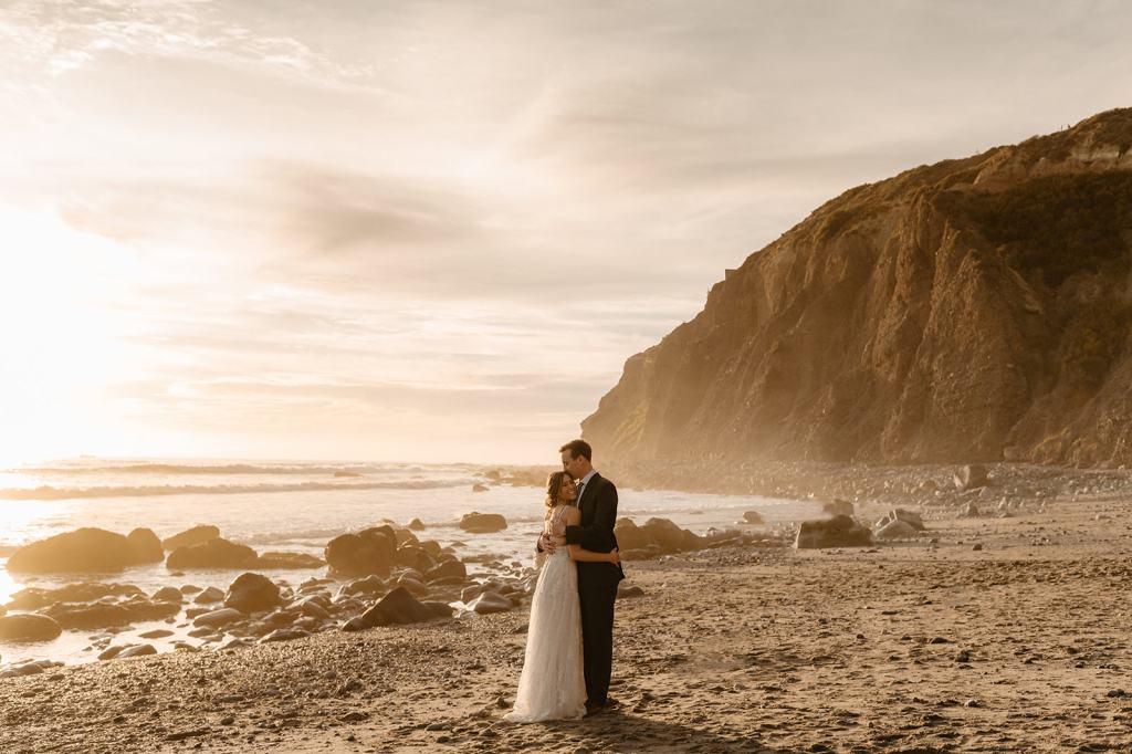 Couple embraces at California coast beach