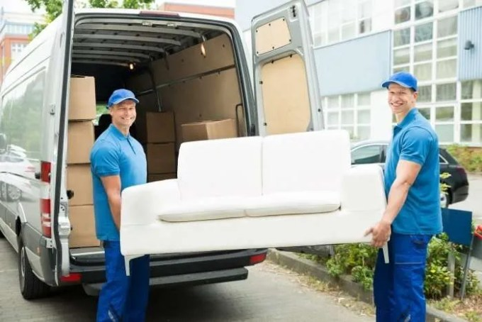two movers carrying a sofa