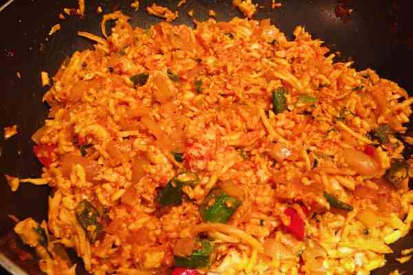 Only half cook the rice if it's to be mixed this is jollof rice nationaldish