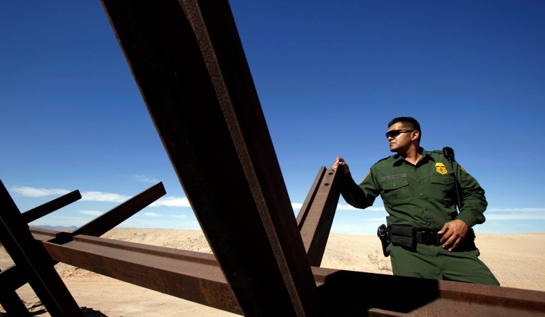 border patrol agent adrian corona looks over to mexico from the us side of the international border near calexico california adjacent to the mexican