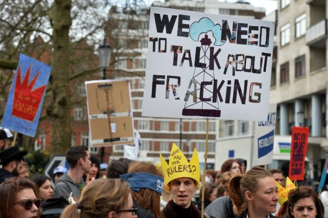 Demonstrators carry placards as they gather for an anti-fracking protest in London on March 19, 2014. Activists and demonstrators joined the Fracked Future Carnival to protest against fracking, the controversial technique that involves using huge amounts of pressurised water mixed with chemicals to crack open shale -- sedimentary rock containing hydrocarbons -- to release natural gas. Environmentalists have warned that the chemical-laced waste could be contaminating fresh water resources. AFP PHOTO / BEN STANSALL (Photo credit should read BEN STANSALL/AFP/Getty Images)