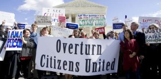 Demonstration outside the U.S. Supreme Court to bring attention to reconsideration of the Citizens United v. FEC decision. February 23, 2012. Image credit: Diego M. Radzinschi/THE NATIONAL LAW JOURNAL.