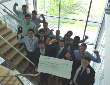 Early Careers Scheme engineers present a cheque to Hayley Callacher from Cancer Research UK