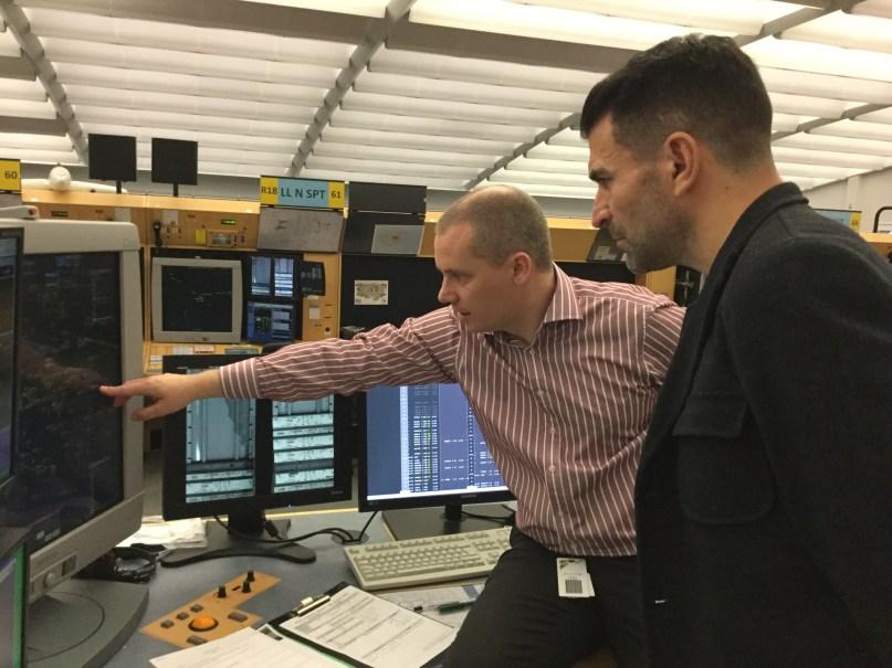 Brian Wheeler (back) shows Franny Benali a radar screen