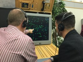 Brian Wheeler (left) and Franny Benali listen to air traffic controllers speaking to pilots