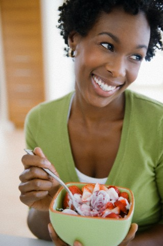 Young woman eating a healthy desert