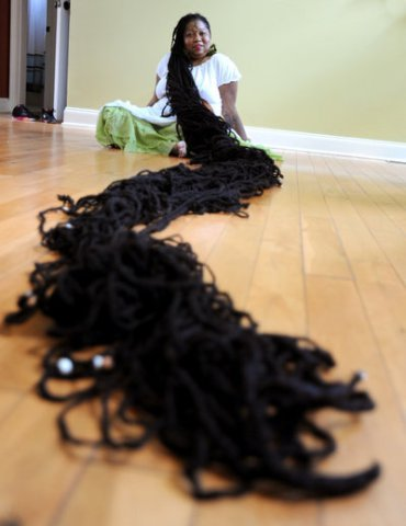 Woman With Longest Dreadlocks in the World; Hair Could Potential Paralyze