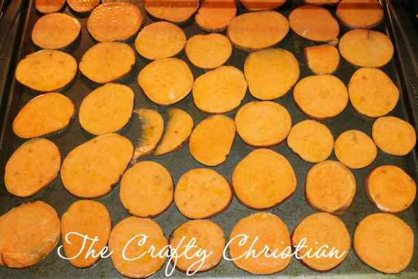 Seasoned sweet potato chips on a cookie sheet