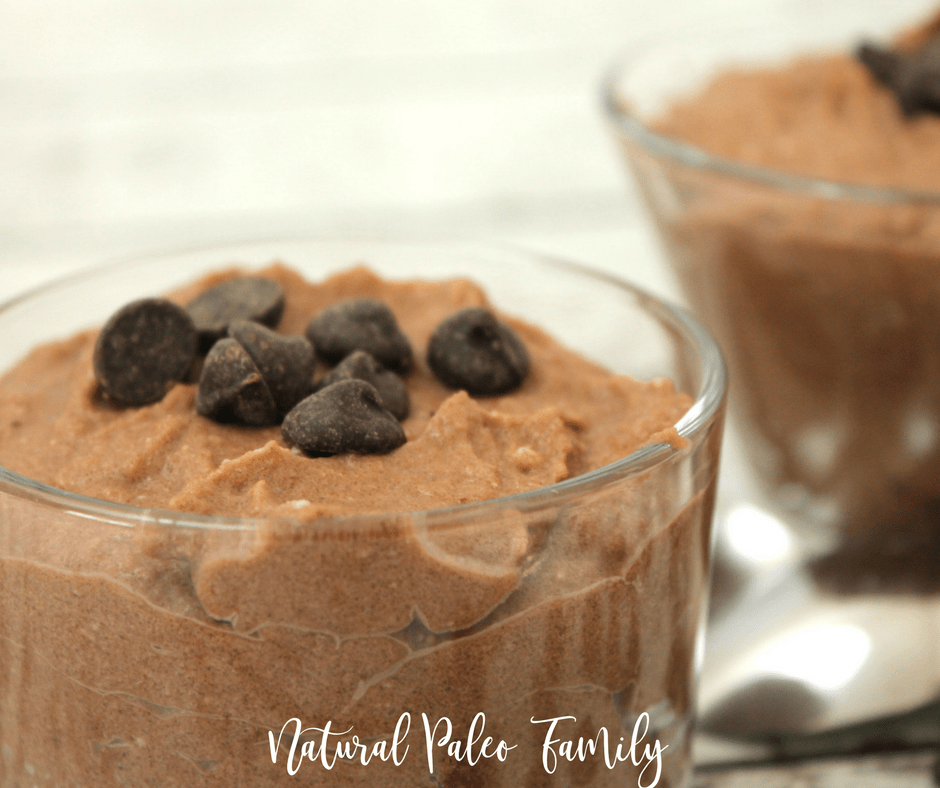 paleo chocolate banana pudding in small glass bowls with chocolate chips on top