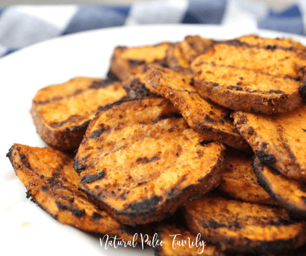 pile of grilled sweet potatoes on a white plate