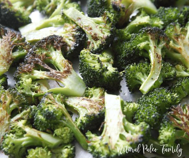 Closeup of garlic roasted broccoli on a baking sheet