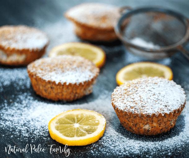 paleo lemon poppyseed muffins with powdered sugar sprinkled on top