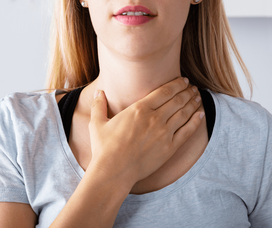 woman touching her thyroid