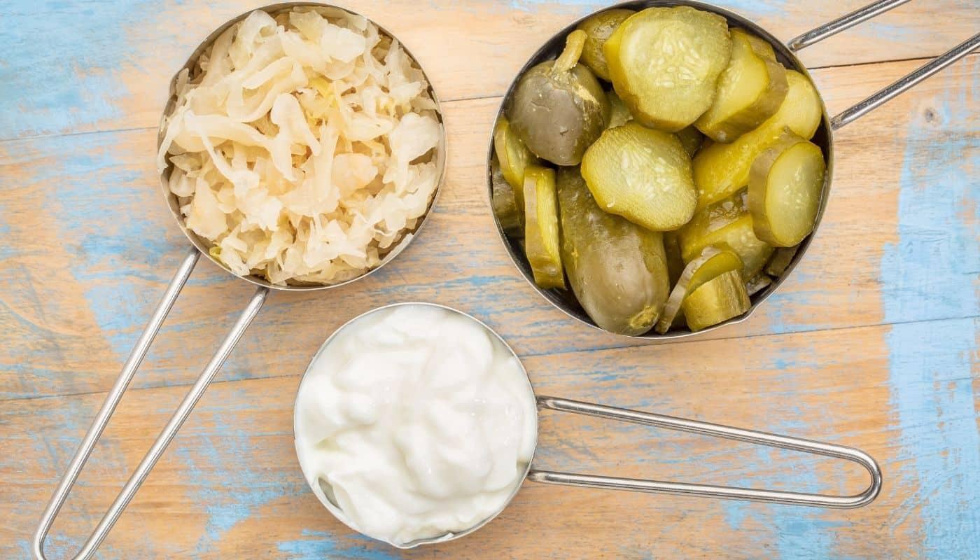 Healthy gut foods like pickles, sauerkraut, and yogurt