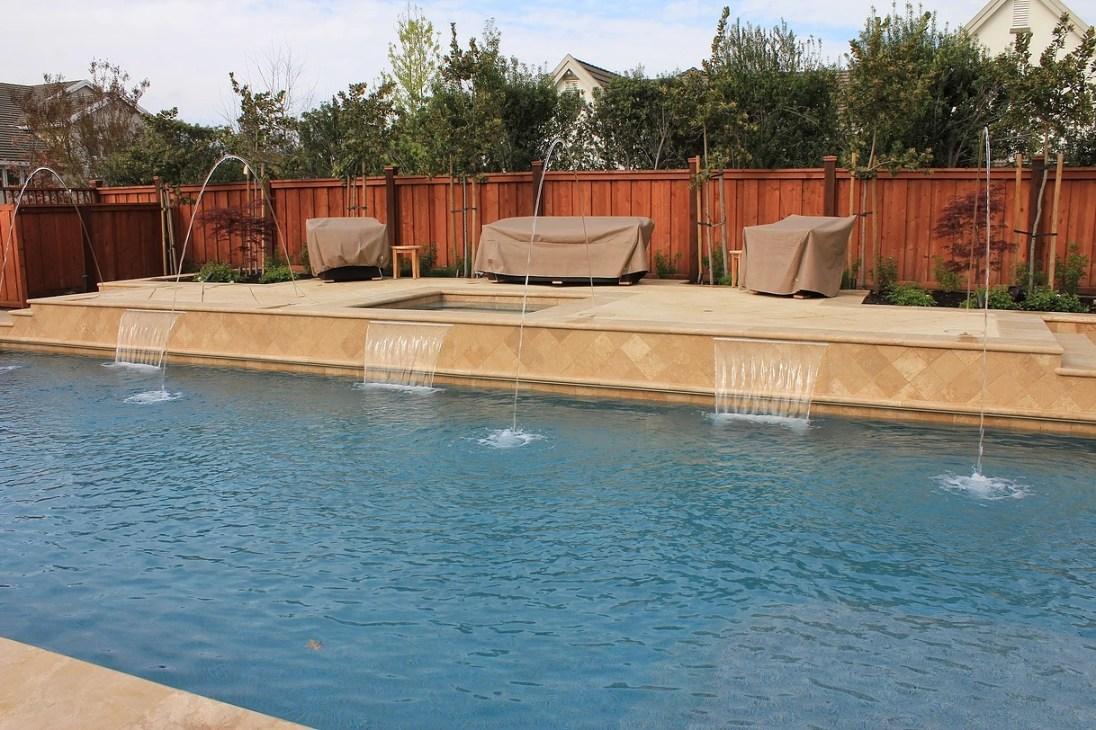 Walnut Travertine pool coping around the pool