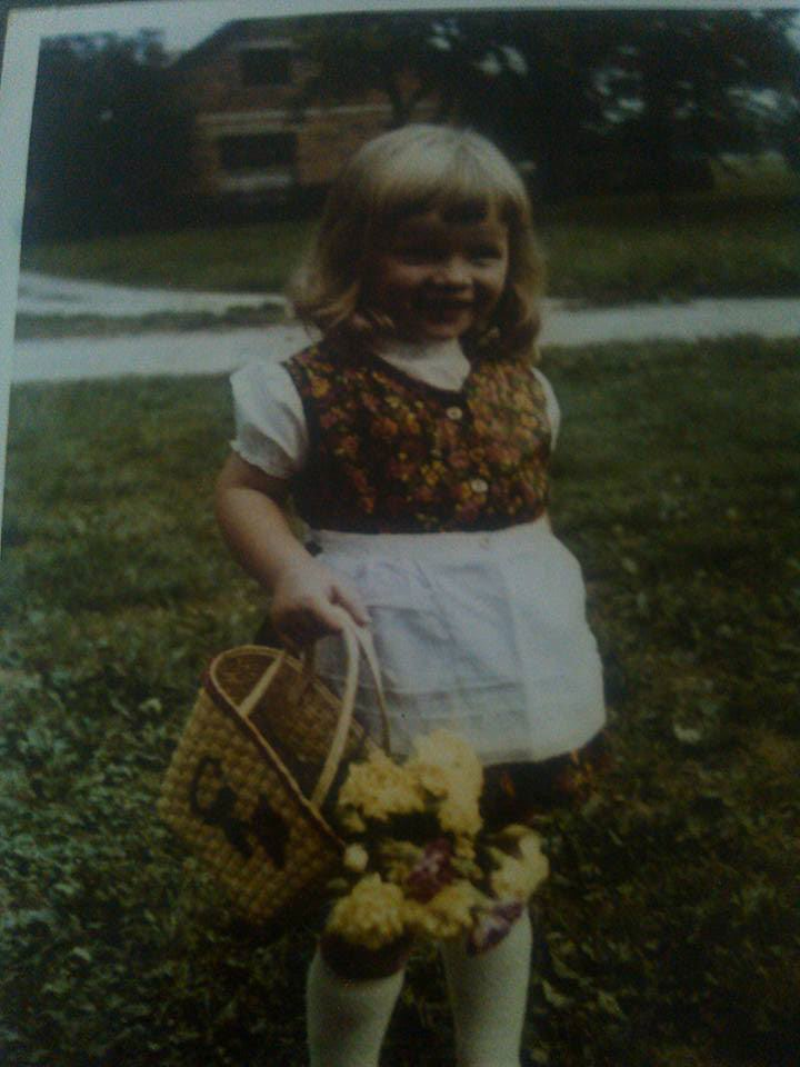 Mateja Petje Slovenia childhood picture flowers basket Happy family