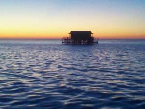 stilt house sunset