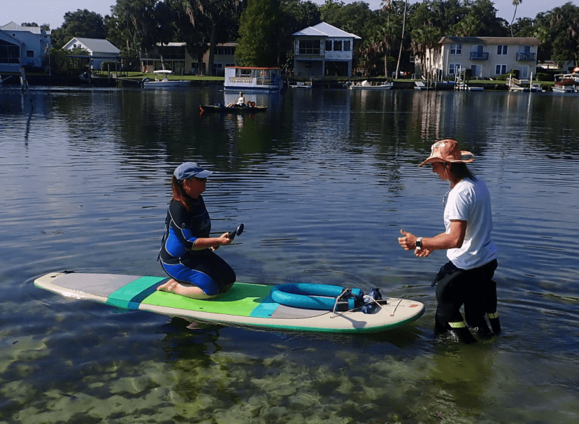 kneeling on a SUP