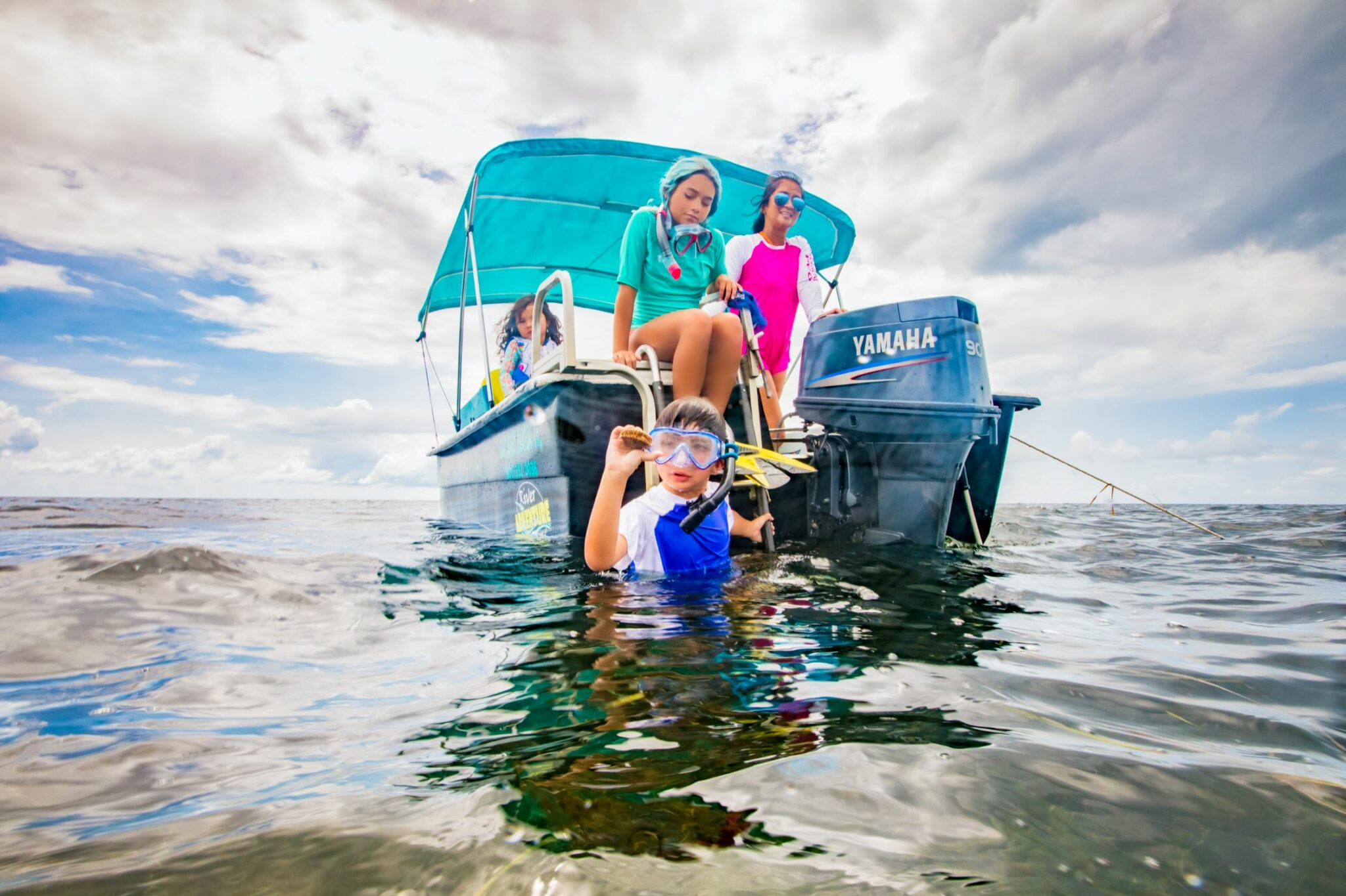 Family on a boat scalloping together