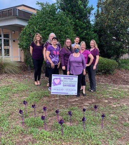 """This year, World Elder Abuse Awareness Day fell on Tuesday, June 15. Citrus County Support Services employees and volunteers gathered outside of the Citrus County Resource Center at the """"Purple Pinwheel Garden"""" to bring awareness to this important subject."""