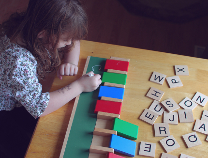 Spelling Words with Wooden Letter Tiles
