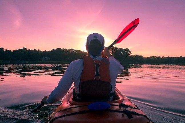 man kayaking on a lake
