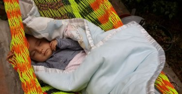 Baby sleeping in hammock