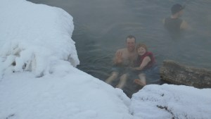 Tom and Calvin swim in the Boiling River