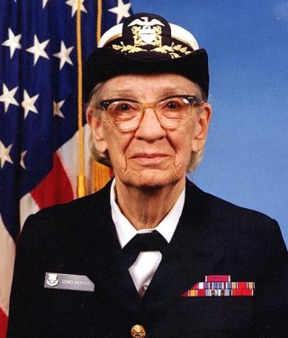A photograph of Rear Admiral Grace Murray Hopper in uniform.