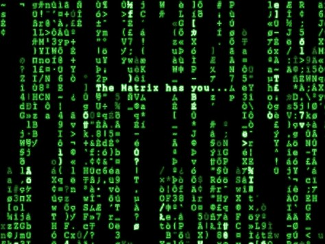 "A photograph showing an old-fashioned computer screen showing a lot of data in green font type on the black screen background and the words ""The Matrix has you..."" is displayed in the centre."