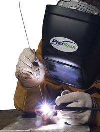 A photograph showing a heavy welder at worker. Helium Argon Shielding Gas Primer for GTAW Gas Tungsten Arc Welding.