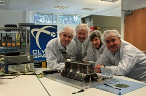 A photograph showing the First Minister of Scotland, Alex Salmon, visiting Clyde Space, pictured here with the micro-satellite and research team.