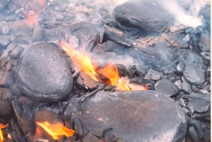 A photograph showing a natural oil shale fire burning on the cliffs of Dorset, England, in United Kingdom.