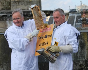 A photograph showing Councillor Matheson and PlanBeeLtd Director Warren Bader with Glasgow bees.
