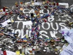 A photograph taken Place de la République, in Paris, in the aftermath of the Charlie Hebdo shootings on 07 January 2015. Tributes left included those pencils arranged in the shape of a peace symbol.